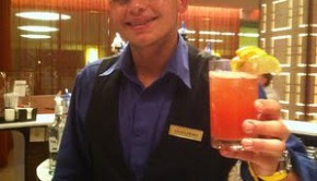 Cheers: Bartender Guillermo creates a tasty rum punch at the Conrad Condado Plaza hotel in Puerto Rico.
