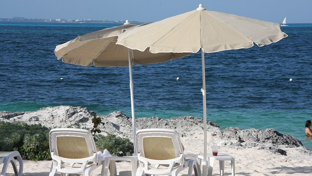 The beach at the Riu Palace Peninsula hotel is a good place to escape from work in Cancun.