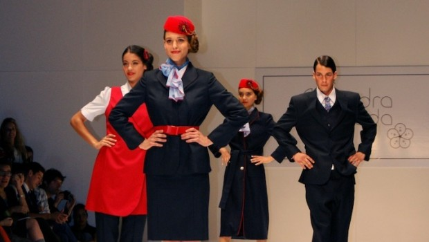 Aeromexico's flight attendant uniforms feature bold red accents.