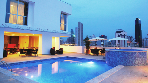 The attractive rooftop pool at the Hotel Tryp Panama Centro offers views of the Panama City skyline.