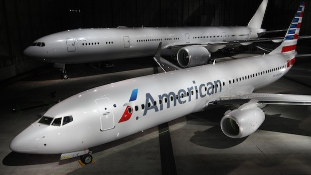 An unpainted American Airlines 777-300 and a Boeing 737-800 with American's new look.
