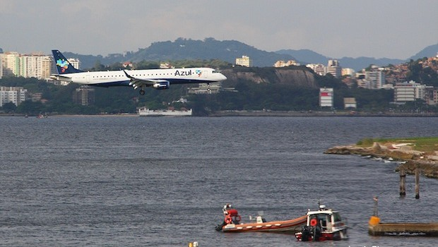 Azul Linhas Aereas (Azul Airlines) Embraer close to the water at Santos Dumont airport.