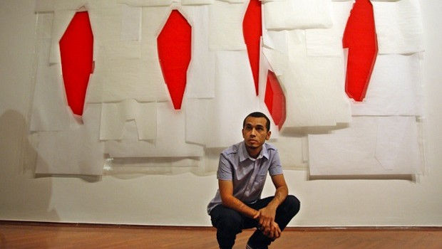 Venezuelan artist Camilo Barboza, with his work at the Carmen Araujo Arte gallery.