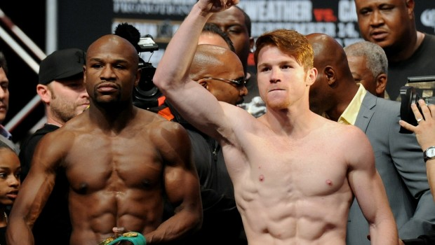"Floyd Mayweather Jr. and Saul ""Canelo"" Alvarez pose after their weigh-in. Photo: Las Vegas News Bureau"
