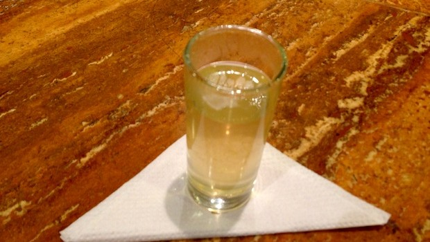 A warm glass of canelazo, served at The lobby at the Hotel Oro Verde Cuenca.