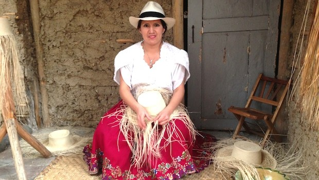 A woman shows traditional techniques for making Panama hats.