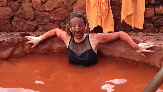 Tanja Laden of PopCurious.com enjoys a red mud bath in Cuenca, Ecuador.
