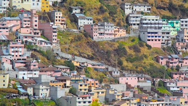 Colorful homes dot the hillsides of Quito, Ecuador.