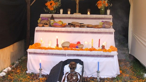 Religious icons and skeletons are part of the Day of the Dead altars.