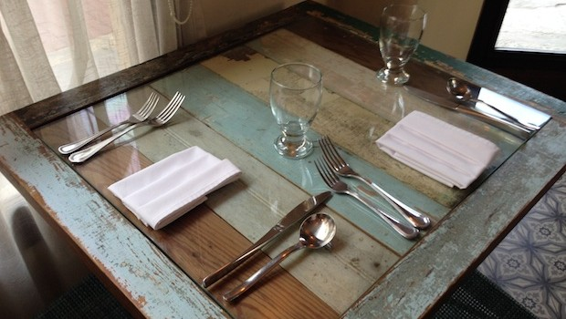 Tables at Las Clementinas restaurant are made partly from salvaged material.
