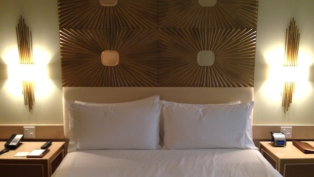 Stylish gold-hued headboard at Waldorf Astoria Panama.