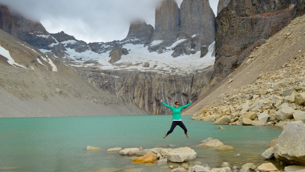 Caroline Michaud jumps for joy at Torres del Paine national park in Chile.