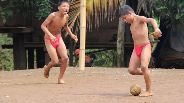 Embera boys play a variation of soccer in Panama.