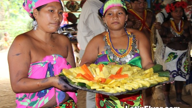 Embera women serve fresh fruit for dessert.