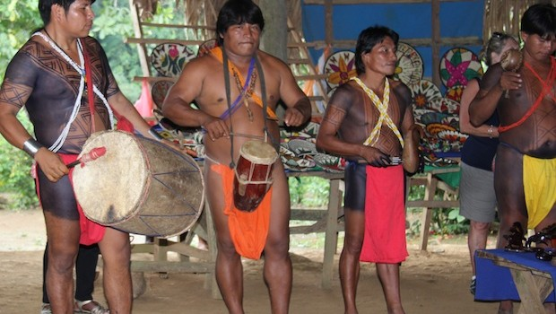 Embera men provide visitors with traditional live music in Panama.