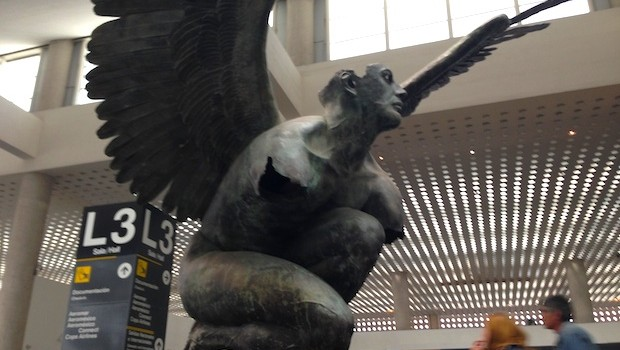 Winged man bronze sculpture by Jorge Marin at Mexico City airport.