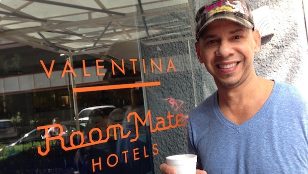 Angel enjoys a cup of coffee at the entrance to Room Mate Valentina hotel.