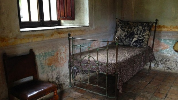 Antique bed and chair at Hacienda Jalisco, near Puerto Vallarta.
