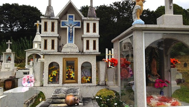 This elaborate grave, at San Sebastian cemetery in Mexico, resembles a church.