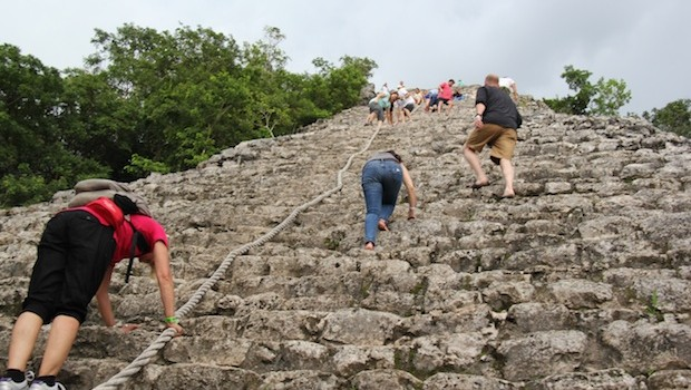Climbing the Mayan ruins at Coba.