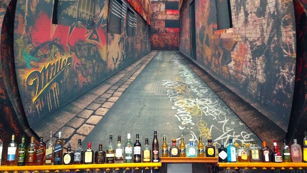 A wall mural graces the lobby bar at Tantalo hotel in Panama.
