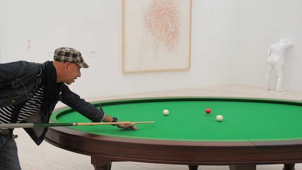 "Angel tries out ""Oval Billard Table,"" by Mexican artist Gabriel Orozco, at Museo Jumex."