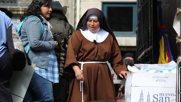 A nun sells fresh food on Calle Madero, Mexico City.
