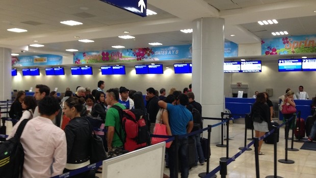 Copa Airlines economy check-in at Cancun airport.