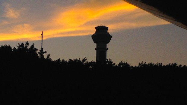 The control tower at sunrise, at Cancun airport.