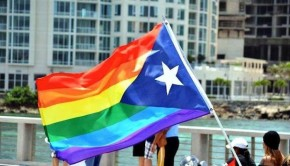 A gay pridel hybrid of a rainbow flag and Puerto Rican flag.