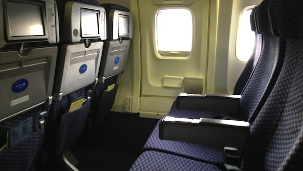 Economy airline seating aboard United Airlines Boeing 737.