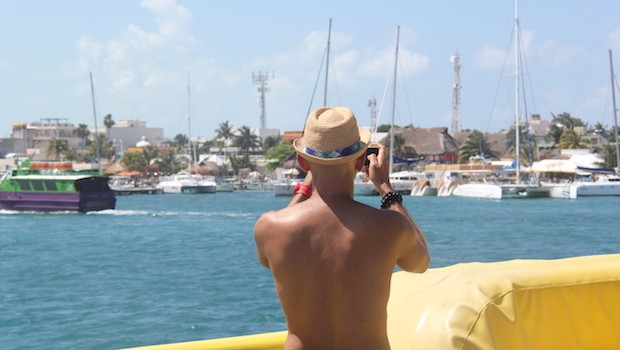 Angel photographs boats at the dock at Isla Mujeres, Mexico.