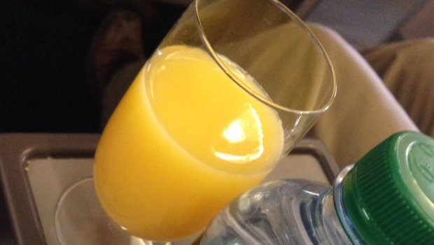 Orange juice served before departure in first class on Delta Airlines Airbus A320.