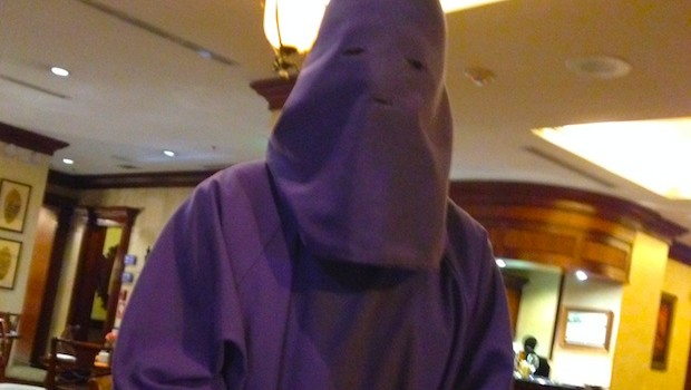 A waiter dressed as a penitent at Hotel Plaza Grande in Quito.