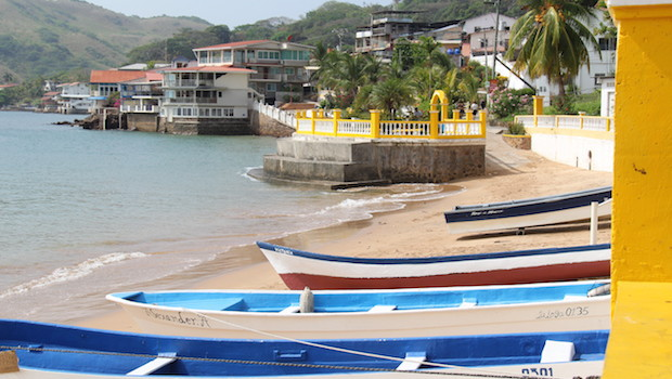 Colorful fishing boats line the beach on Taboga island in Panama.
