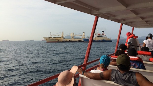 The ferry ride to Taboga island offers views of ships entering the Panama Canal.