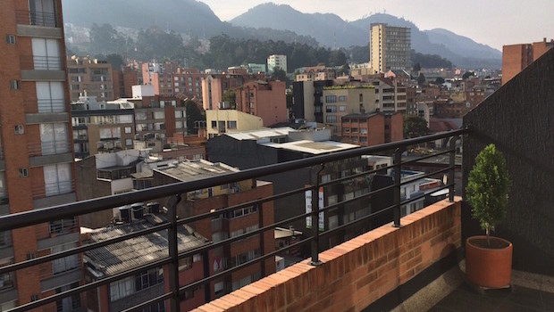 Bogota city view from the upper balcony at Airbnb apartment rental.