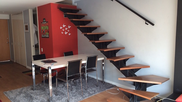 Dining area and staircase at Airbnb apartment rental in Bogota, Colombia.