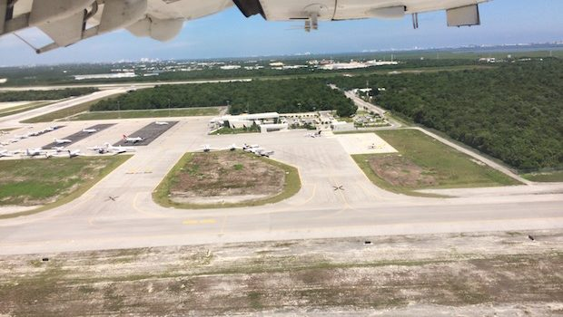Taking off from Cancun airport, with FBO Terminal below.
