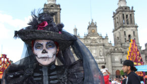 Traditional catrina garb at the first Mexico City Day of the Dead parade.