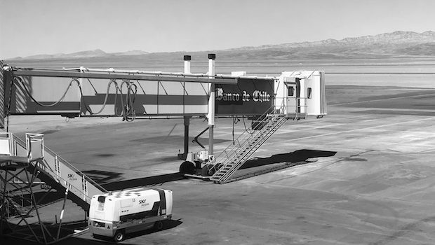 A jetway extends toward the desert at the Calama airport in Chile.