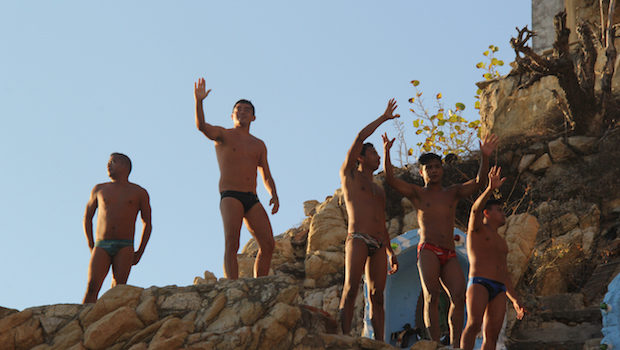 The Acapulco cliff divers greet their audience.