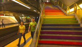 Colors of the gay pride flag grace the stairs at the renamed Subte station.