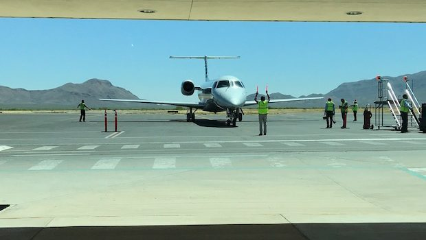 American Eagle Embraer airliner taxis to the gate in Chihuahua, Mexico.