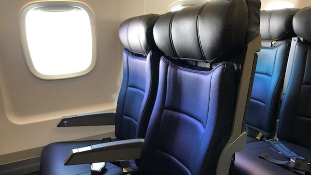 Airline seats aboard the American Eagle Embraer.