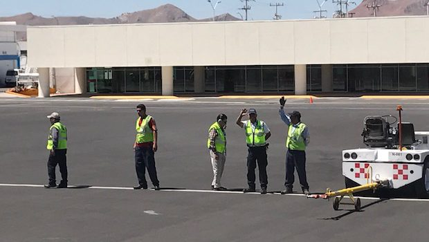 Chihuahua airport ground crew waves goodbye to our plane.