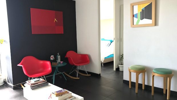 The mod decor at this Airbnb apartment in Bogota has splashes of color.