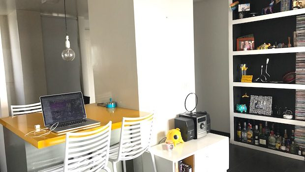 Love the cheery colors and practical layout of this Airbnb apartment.