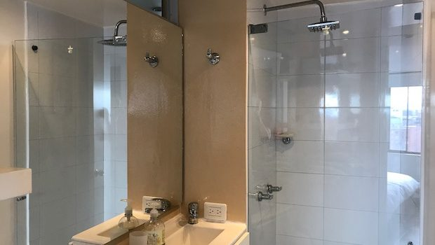 Both bathrooms have shower stalls in the Airbnb apartment in Bogota.