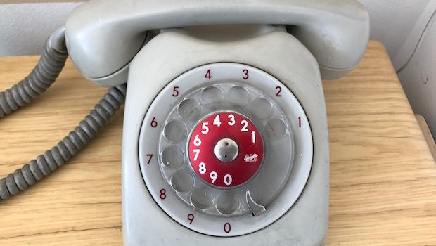 A retro-style phone is among the cool decor touches at this Airbnb apartment.